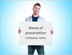 Шаблон презентации PowerPoint: Молодой парень держит белый плакат
